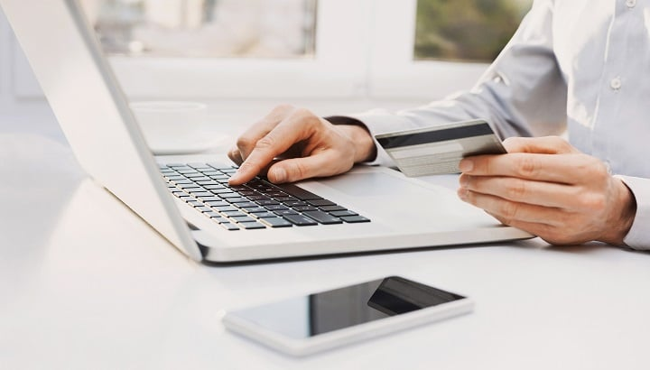 Man is shopping online with laptop